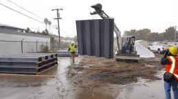 Crews are installing a vinyl pile sheet wall in the Rock Springs neighborhood.