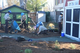 California Conservation Corps workers help lay mulch in front of the donated barn and chicken run.