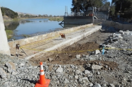 The damaged apron is removed to inspect the dam's foundation.